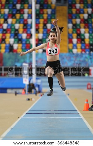 ISTANBUL, TURKEY - DECEMBER 26, 2015: Athlete Simay Nur Ergin triple jumps during Turkish Athletic Federation Indoor Athletics Record Attempt Races