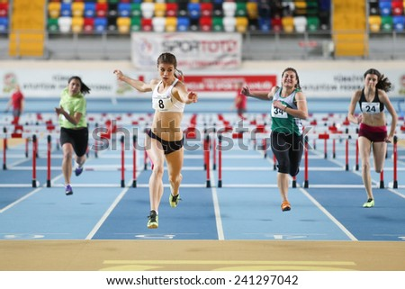 ISTANBUL, TURKEY - DECEMBER 28, 2014: Athletes run steeplechase during Athletics record attempt races in Asli Cakir Alptekin Athletics hall, Istanbul. - stock photo