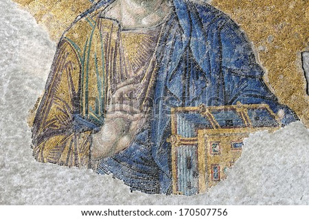 ISTANBUL, TURKEY - DECEMBER 21: Jesus Christ, a Byzantine mosaic hand&book detail in the interior of Hagia Sophia, on December 21, 2013 in Istanbul. - stock photo