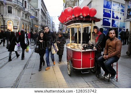 ISTANBUL-TURKEY: FEB 14: Unidentified people walk through the Istiklal Street to celebrate Valentine's Day on February 14, 2013 in Istanbul,Turkey.It's one of the popular destinations in Istanbul. - stock photo