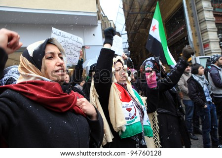 ISTANBUL, TURKEY-FEBRUARY 9: A group of people stage a demonstration in front of the Syrian Consulate, protesting Syrian authorities' violent crackdown in Homs, on Feb 9, 2012 in Istanbul,Turkey - stock photo