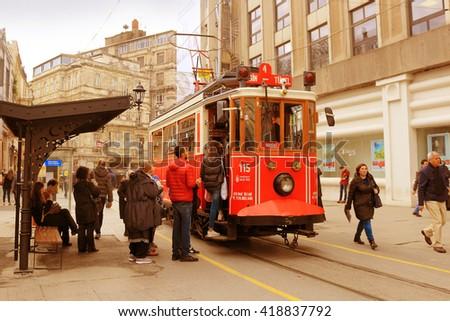 ISTANBUL, TURKEY - FEBRUARY 17, 2016: A vintage tram on Istiklal Caddesi in Taksim, Beyoglu area, Istanbul, Turkey - stock photo