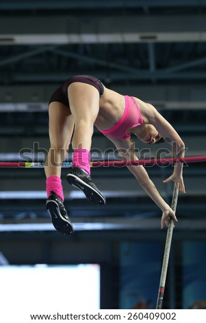 ISTANBUL, TURKEY - FEBRUARY 14, 2015: Athlete Buse Arikazan pole vaulting during Turkcell Juniors and Seniors Athletics Turkey Indoor Championship in Asli Cakir Alptekin Athletics hall - stock photo