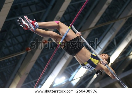 ISTANBUL, TURKEY - FEBRUARY 14, 2015: Athlete Demet Parlak pole vaulting during Turkcell Juniors and Seniors Athletics Turkey Indoor Championship in Asli Cakir Alptekin Athletics hall - stock photo