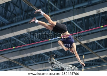 ISTANBUL, TURKEY - FEBRUARY 25, 2016: Athlete Etamar Bhastiker pole vaulting in Athletics Istanbul Indoor Championships - stock photo
