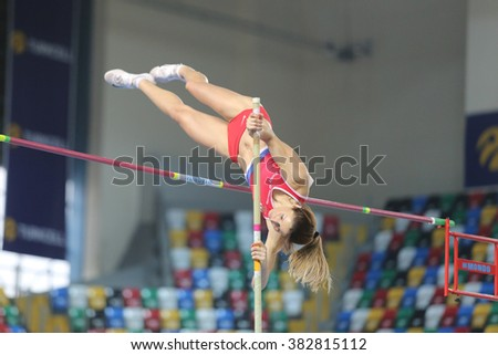 ISTANBUL, TURKEY - FEBRUARY 27, 2016: Athlete Jelena Damnjanovic pole vaulting in Balkan Athletics Indoor Championships - stock photo