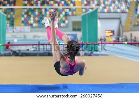 ISTANBUL, TURKEY - FEBRUARY 15, 2015: Athlete Merve Menekse high jump during Turkcell Juniors and Seniors Athletics Turkey Indoor Championship in Asli Cakir Alptekin Athletics hall - stock photo