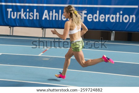 ISTANBUL, TURKEY - FEBRUARY 01, 2015: Athlete Meryem Kasap run during Turkish Athletic Federation Olympic Threshold Indoor Competitions in Asli Cakir Alptekin Athletics hall - stock photo
