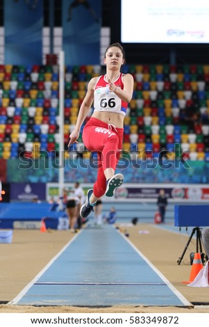 ISTANBUL, TURKEY - FEBRUARY 12, 2017: Athlete Milica Gardasevic long jumping during Balkan Junior Indoor Championships