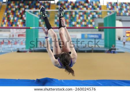 ISTANBUL, TURKEY - FEBRUARY 15, 2015: Athlete Miray Akbulut high jump during Turkcell Juniors and Seniors Athletics Turkey Indoor Championship in Asli Cakir Alptekin Athletics hall - stock photo