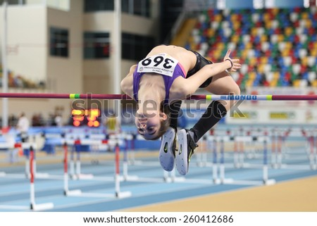 ISTANBUL, TURKEY - FEBRUARY 15, 2015: Athlete Miray Akbulut high jump during Turkcell Juniors and Seniors Athletics Turkey Indoor Championship in Asli Cakir Alptekin Athletics hall - stock photo