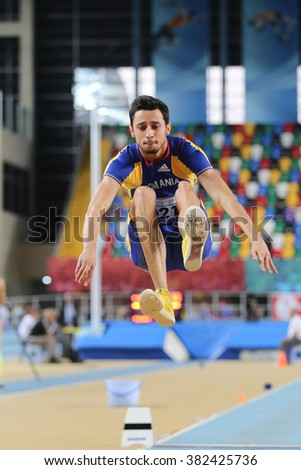 ISTANBUL, TURKEY - FEBRUARY 25, 2016: Athlete Staicu Cristian Iulian long jumping in Athletics Istanbul Indoor Championships