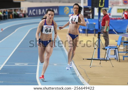 ISTANBUL, TURKEY - FEBRUARY 21, 2015: Athletes running 4x400 relay race during Balkan Athletics Indoor Championships in Asli Cakir Alptekin Athletics hall. - stock photo