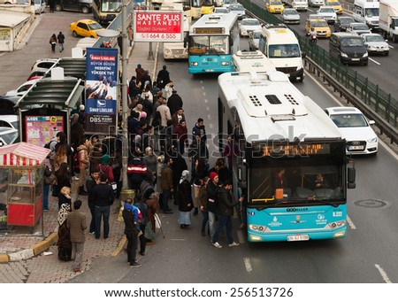 ISTANBUL, TURKEY - FEBRUARY 25, 2015: Bahcelievler district in istanbul.Turkish people ride on bus - stock photo