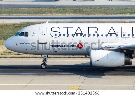 ISTANBUL , TURKEY - FEBRUARY 9, 2015: Detail image of an aircraft of Turkish Airlines, is  at Istanbul Ataturk International Airport on February 9, 2015 . Aircraft is an Airbus A320  - stock photo