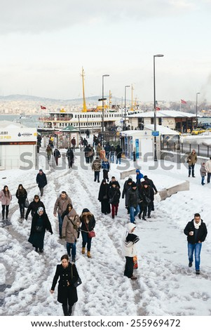 ISTANBUL, TURKEY - FEBRUARY 19, 2015: istanbul winter a day.Turkish people walking in Eminonu district on a snowy day - stock photo
