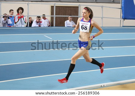 ISTANBUL, TURKEY - FEBRUARY 21, 2015: Rumanian athlete Bobocea Claudia running during Balkan Athletics Indoor Championships in Asli Cakir Alptekin Athletics hall. - stock photo