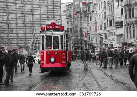 ISTANBUL,TURKEY- February 02: Unidentified pedestrians walk down Istiklal Street on a snowy day on February 02, 2016 in Istanbul, Turkey.Istiklal Street is one of the popular destinations in Istanbul. - stock photo