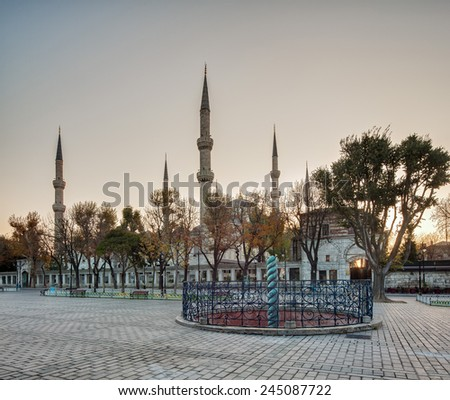 Istanbul.Turkey. Hippodrome. Snake column. Blue Mosque (Sultan Ahmet Camii Mosque) in the Sultanahmet area of Istanbul in Turke - stock photo