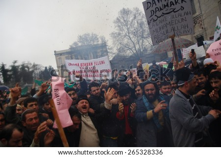 ISTANBUL, TURKEY - JAN  07: Undefined demonstrators protested against the publication of cartoons of the Prophet Muhammad on January  07,2006 in Istanbul,Turkey. - stock photo