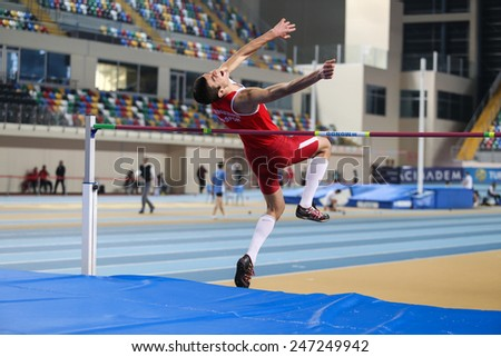ISTANBUL, TURKEY - JANUARY 17, 2015: Athlete Enes Talha Senses high jump during Ruhi Sarialp clubs jumping championship and athletics record attempt races in Asli Cakir Alptekin Athletics hall