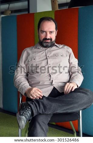 ISTANBUL, TURKEY - JANUARY 3: Famous Turkish businessman and online food ordering company 'Food Basket' (Yemek Sepeti) founder Nevzat Aydin portrait on January 3, 2013 in Istanbul, Turkey. - stock photo