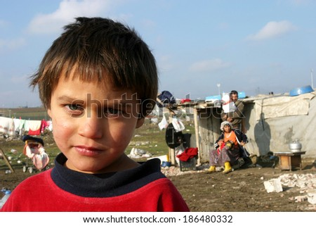 ISTANBUL, TURKEY - JANUARY 8: Gypsy child at Silivri Gypsy Camp on January 8, 2008 in Istanbul, Turkey. - stock photo