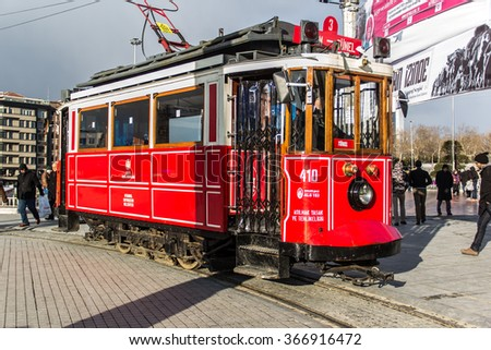 ISTANBUL, TURKEY - JANUARY 23, 2016: Retro tram moves along a busy Istiklal street in Istanbul. Red train to Taksim Square