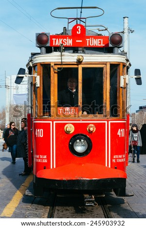 ISTANBUL, TURKEY - JANUARY 20: Taksim Istiklal Street at eventide on January 20, 2015 in Istanbul, Turkey. Taksim Istiklal Street is a popular destination in Istanbul. Nostalgic tram of Istanbul.  - stock photo