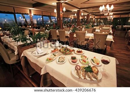 ISTANBUL, TURKEY - JANUARY 6: Traditional Turkish fish food on the restaurant table on January 6, 2010 in Istanbul, Turkey. - stock photo