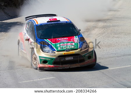 ISTANBUL, TURKEY - JULY 13, 2014: Murat Bostanci drives Ford Fiesta S2000 of Castrol Ford Team Turkey in 35. Istanbul Rally, Ulupelit ITO Stage