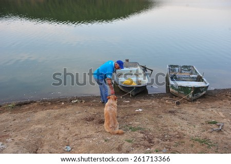 ISTANBUL ,TURKEY - JULY 16:  Old fisherman and his dog on July 16, 2012 in Istanbul, Turkey.