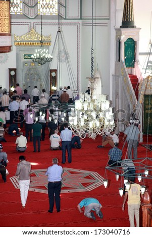 ISTANBUL, TURKEY - JULY 23: People praying at Arap Mosque on July 23, 2013 in Istanbul, Turkey. Arap Mosque building was originally a Roman Catholic Church erected in 1325.