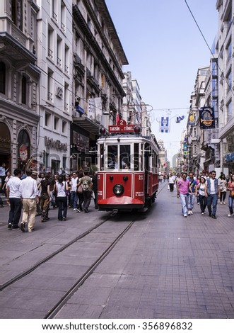 ISTANBUL, TURKEY - July 5: Taksim Istiklal Street at eventide on July 5, 2009 in Istanbul, Turkey. Taksim Istiklal Street is a popular destination in Istanbul. Nostalgic tram of Istanbul. - stock photo