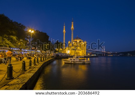 ISTANBUL TURKEY - July, 7th 2014: People resting at  jetty of Ortakoy on July, 7th 2014. Ortakoy is the one of the most beautiful landmark of Istanbul. - stock photo