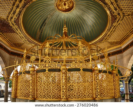 ISTANBUL, TURKEY - JULY 9, 2014: The golden interior of Fountain  for ritual ablutions in Hagia Sophia social complex, Istanbul, Turkey - stock photo