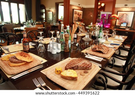 ISTANBUL, TURKEY - JUNE 25: Hamburger, steaks and chops menu on the dinner table in the restaurant on June 25, 2013 in Istanbul, Turkey. - stock photo