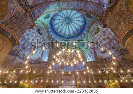 ISTANBUL, TURKEY - JUNE 11: Interior decoration of Blue Mosque on June 11, 2014 in Istanbul. The Mosque was built from 1609 to 1616, during the rule of Sultan Ahmed I - stock photo