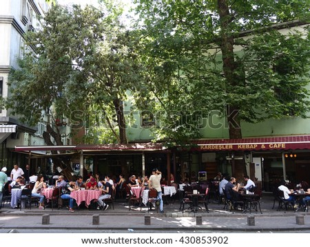 ISTANBUL, TURKEY - JUNE 02, 2016:Sidewalk cafe in Cihangir street.Cihangir of Beyoglu quarter is the city's oldest antiques district on JUNE 02, 2016 in Istanbul, Turkey - stock photo