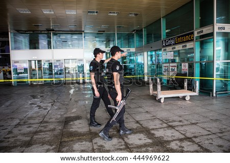 ISTANBUL, TURKEY - JUNE 29: Turkish policemen stand in a cordon off street after a suicide bomb attack at Ataturk Airport in Istanbul on June 29, 2016 in Istanbul, Turkey.