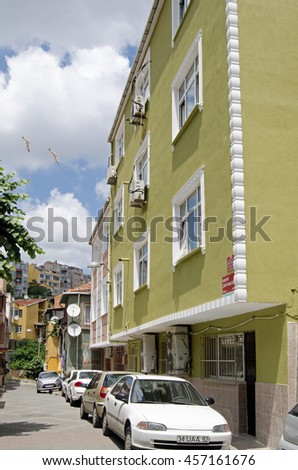 ISTANBUL, TURKEY - JUNE 5, 2016:  View along a street of apartments in the Balaat suburb of Istanbul on a sunny day in early summer.