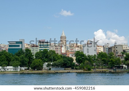 ISTANBUL, TURKEY - JUNE 5, 2016:  View from the Golden Horn looking towards the Beyoglu district of Istanbul with the historic Galata Tower dominating the skyline on a sunny afternoon in June.