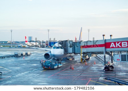 ISTANBUL, TURKEY - MAR 2, 2014: Turkish Airlines aircraft parked in the Istanbul Ataturk Airport, the 17th busiest airport in the world. - stock photo