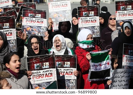 ISTANBUL,TURKEY-MARCH 2:A group of unidentified people stage a demonstration in front of the Beyazit Mosque, protesting Syrian authorities' violent crackdown in Homs on March 2,2012 in Istanbul,Turkey - stock photo