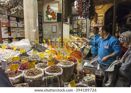 ISTANBUL, TURKEY - MARCH 19, 2011: People shopping in the Egyptian Bazaar also known as Spice Bazaar. This is one of the largest covered markets  in city and is the center for spice trade. - stock photo