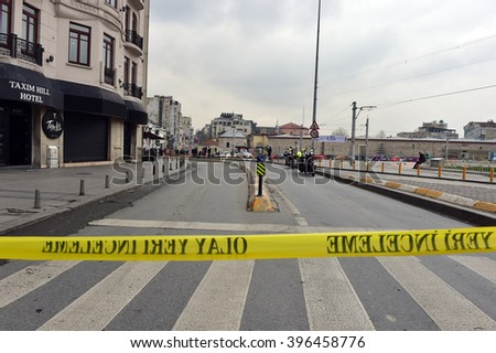 ISTANBUL, TURKEY - March 19: Police  officers attend the scene after an explosion in front of the  in Taksim Square in Istanbul on March 19, 2016 in Istanbul, Turkey. - stock photo