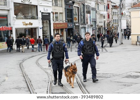 ISTANBUL, TURKEY - MARCH 20: Turkish police patrol with a police dog a day after a suicide bomb attack on March 20, 2016 in Istanbul, Turkey. - stock photo