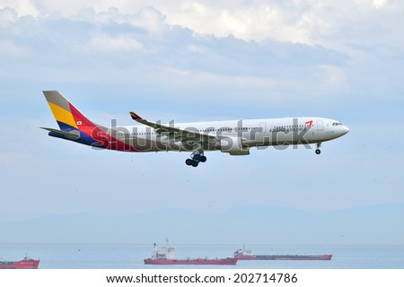 ISTANBUL, TURKEY - MAY 2, 2014: Asiana Airlines Airbus A330 landing at Istanbul Ataturk Airport.  This aircraft, HL8258, was delivered to the Korean air carrier in 2012. - stock photo