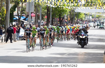 ISTANBUL, TURKEY - MAY 04, 2014: Cyclists in Bagdat street during Istanbul Stage of 50th Presidential Cycling Tour of Turkey.