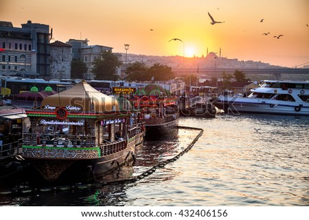 ISTANBUL, TURKEY - MAY 23, 2016: fishermen boat restaurant produce famous fish sandwiches near Galata Bridge, Istanbul, Turkey - stock photo